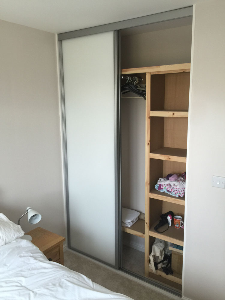 White sliding doors with shelving