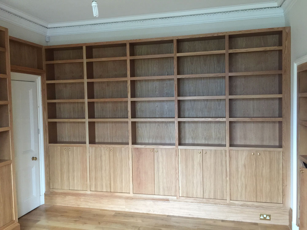 Oak bookcase with lower doors