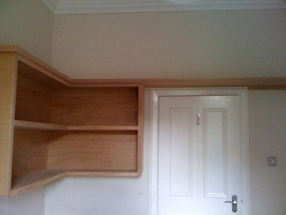 Shelving unit above door