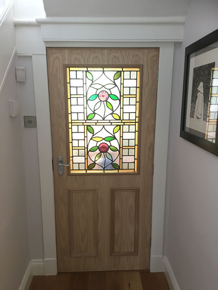 Oak door with stained glass