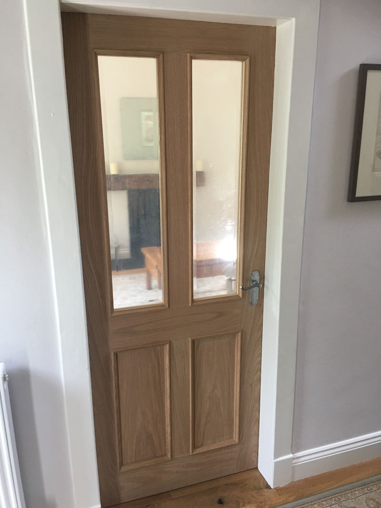 Oak glazed panel door with raised moulding