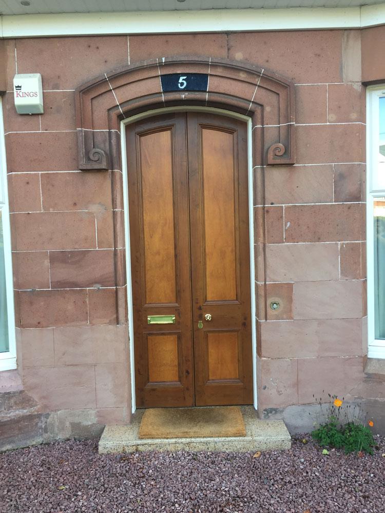 Refurbished storm doors