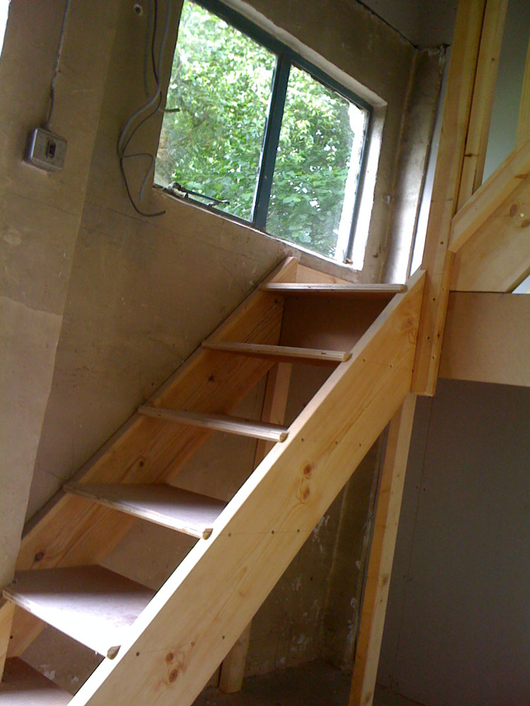 Non regulation stair to attic of garage den in oak
